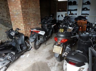 stolen mopeds gang garage 407x305 - The Best Motorcycle Trackers