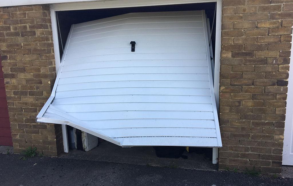 ripped ip garage door - The Best Garage Door Defenders